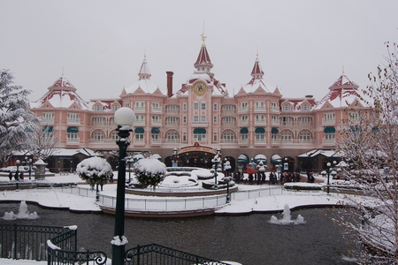 Snow on Disneyland Hotel and entrance to Disneyland Park in Paris