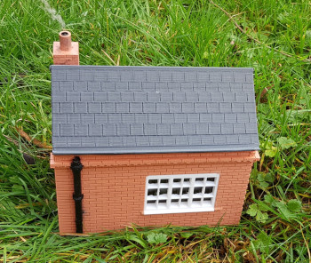 Model railway building with smoke effect generator