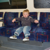 Toddler riding the London underground tube