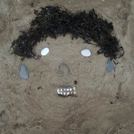 Sandface created from seaweed and stones on Bridlington beach